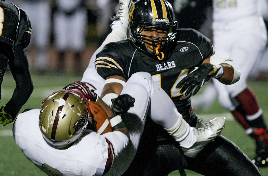 Brennan's Grant Watanabe, a Colorado commit, takes down Leander Rouse's Andre Alger during the fourth quarter of a Class 4A D-I state quarterfinal playoff game at Comalander Stadium on Dec. 6. Photo: Marvin Pfeiffer / San Antonio Express-News / Express-News 2013