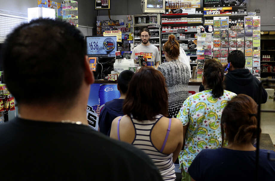 Customers line up to check out, many buying lottery tickets for the Mega Millions drawing as Michael Boston works the register at Diamond Food Mart. Photo: Photos By Lisa Krantz / San Antonio Express-News / San Antonio Express-News