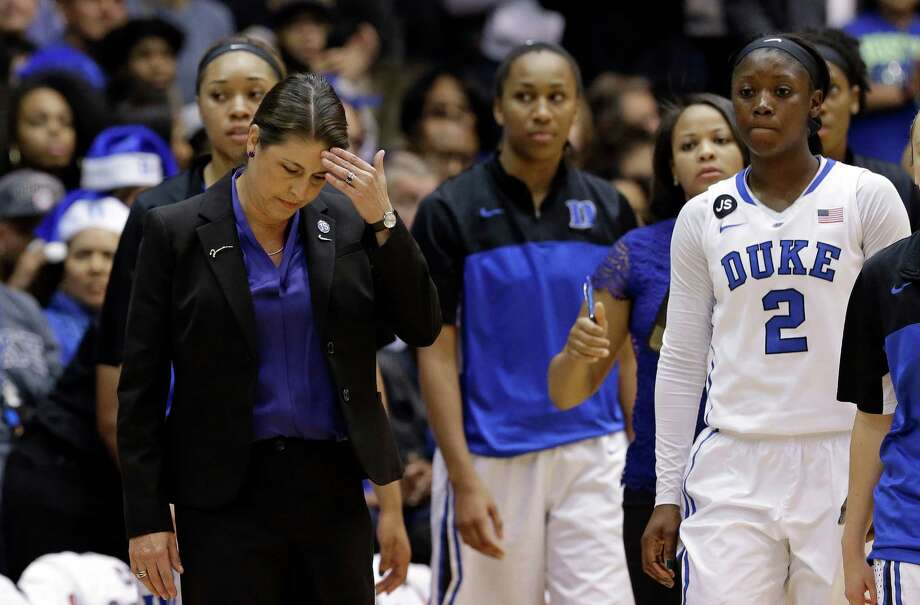 Duke coach Joanne P. McCallie and her players found out Tuesday night how formidable a task it will be for anyone to knock off No. 1 Connecticut. Photo: Gerry Broome, STF / AP
