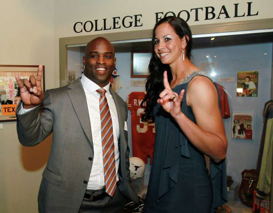 """Former Texas football player and Heisman winner Ricky Williams left, and Texas softball pitcher Cat Osterman, right, give the """"hook 'em horns""""  Texas mascot sign at a reception before the induction for the 2013 class of the Texas Sports Hall of Fame, Monday, Feb. 18, 2013, in Waco, Texas. (AP Photo/Waco Tribune Herald, Jerry Larson) Photo: Jerry Larson, MBO / Waco Tribune Herald"""
