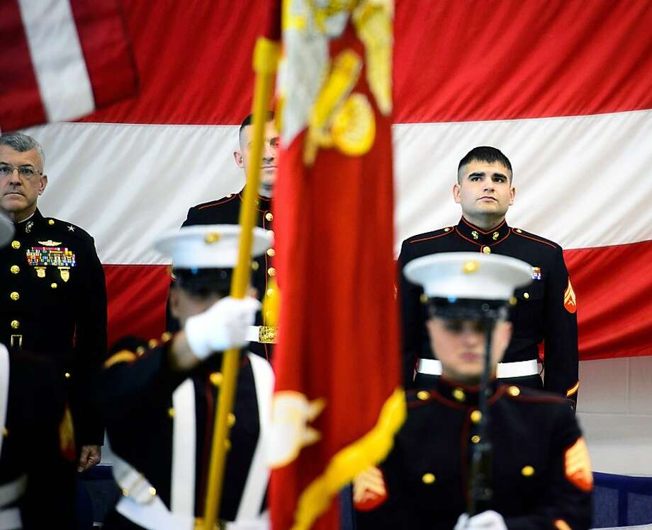 Marine Cpl. Ethan Nagel stands at attention at the ceremony that presenting him with the Silver Star, Tuesday, Dec. 17, 2013 in Minneapolis. Marine Wing Support Squadron 1st Sgt. Michael Ryan says Nagel's heroic actions prevented the possibility of a gravely wounded soldier from being captured by the enemy in Afghanistan in 2009.  (AP Photo/The Star Tribune, Glen Stubbe)  MANDATORY CREDIT; ST. PAUL PIONEER PRESS OUT; MAGS OUT; TWIN CITIES TV OUT Photo: Glen Stubbe, Associated Press