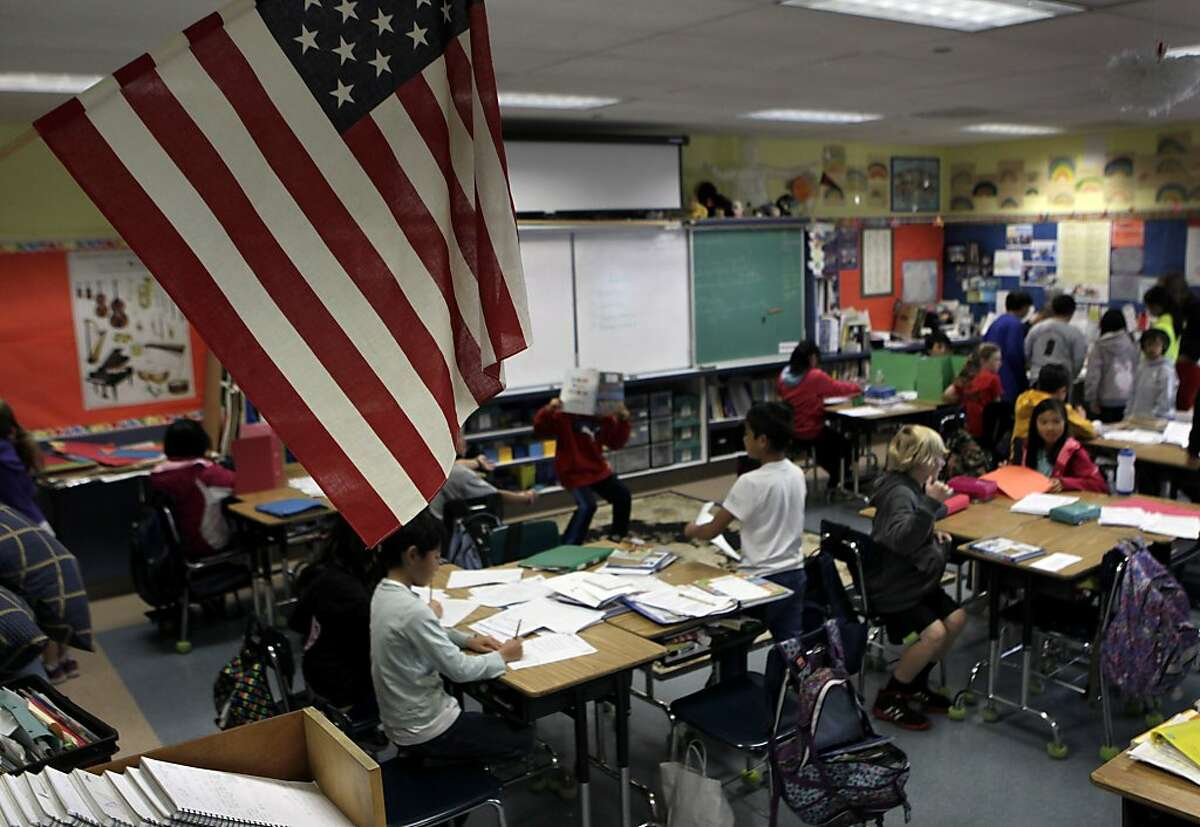 In this file photo, the U.S. flag hangs in David Allyn's 5th-grade classroom at Argonne Elementary School in San Francisco.