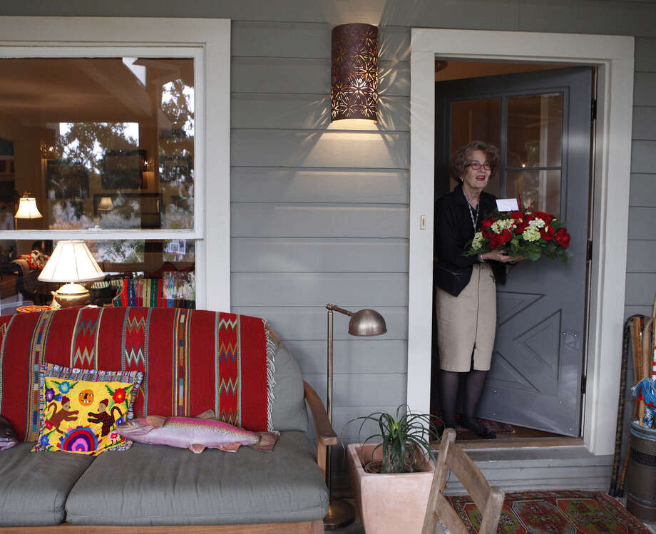"Mary Fisher's screened-in porch was added to the front of the house. The addition ""has changed our lives,"" Mary says. Photo: Cynthia Esparza / For The Express-News / For San Antonio Express-News"