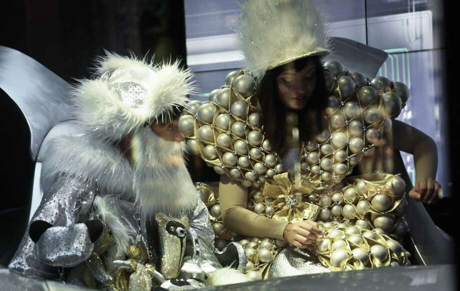 """Live models appear in a Christmas window at Barneys New York called """"Sleigh Ride."""" The window is one of four promoting a collaboration between Barneys and Shawn """"Jay-Z"""" Carter. Photo: Bebeto Matthews / Associated Press / AP"""