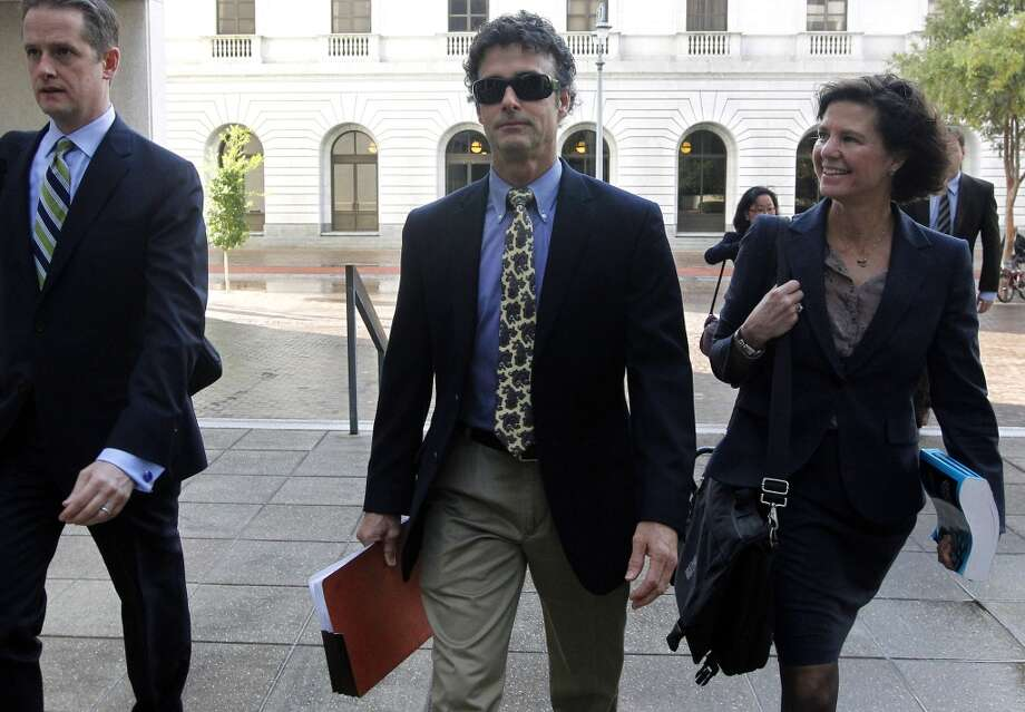 Kurt Mix, center, arrives at the Hale Boggs Federal Building in New Orleans. The former BP drilling engineer was convicted Dec. 18, 2013 of one charge that he deleted text messages from his cellphone to obstruct a federal investigation of the company's massive 2010 oil spill in the Gulf of Mexico. Photo: Jonathan Bachman, Associated Press