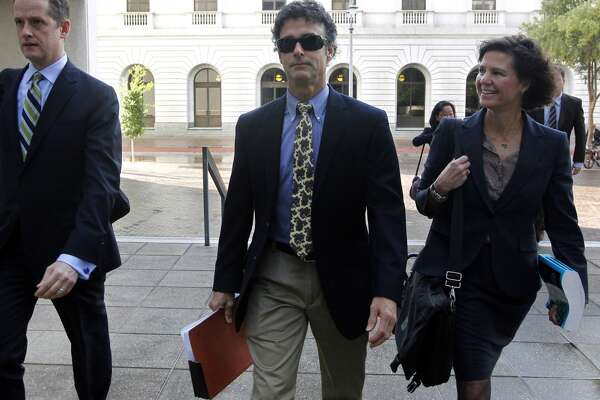 Kurt Mix, center, arrives at the Hale Boggs Federal Building in New Orleans. The former BP drilling engineer was convicted Dec. 18, 2013 of one charge that he deleted text messages from his cellphone to obstruct a federal investigation of the company's massive 2010 oil spill in the Gulf of Mexico.