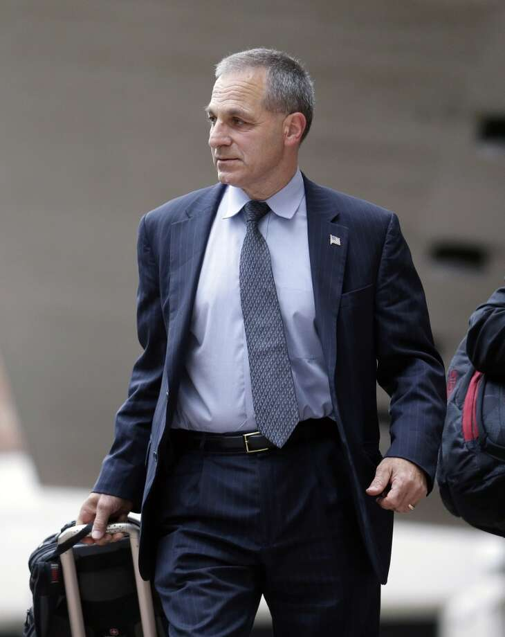 Former FBI Director Louis Freeh leaves Federal Court after meeting with U.S. District Judge Carl Barbier, who appointed Freeh to investigate alleged misconduct by a lawyer who helped run BP's multibillion-dollar settlement fund for the Gulf oil spill. Freeh recommended Friday, Sept. 6, 2013, that the Justice Department investigate whether several lawyers plotted to corrupt the settlement program designed to compensate victims of BP's 2010 Gulf oil spill. Photo: Gerald Herbert, Associated Press