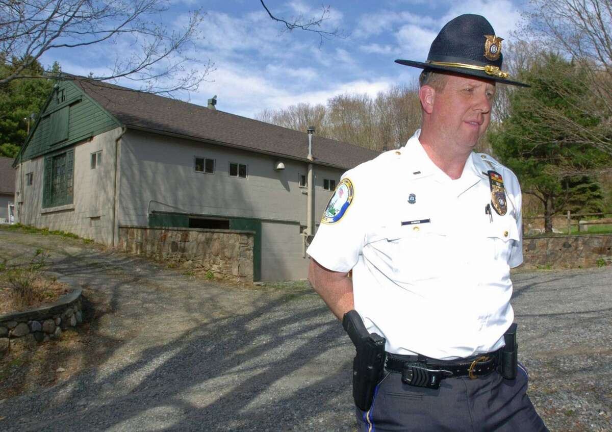 FILE - Lt. George Sinko, of Newtown Police Department, holds a press conference at 89 Poverty Hollow Road in Newtown, April 15, 2010.