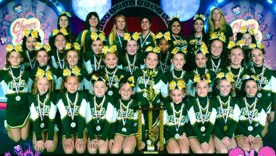National champs!  The New Milford Bulls' Pee Wee White cheerleaders captured the Pop Warner cheerleading national championship for Level 3 last week in competition in Orlando, Fl. Contributing to the team's success were, from left to right, front row, Gillian Corgan, Olivia Sarko, Lilly McDermott, Gracie Marello, Leah Farrell, Madisyn Martinelli, Kelsey OíSullivan and Julia Colley; second row, Valerie Martarella, Abby Farrell, Sophie Lefebvre, Abby Pavlinsky, Alexandra Tsantilis, Sydney Crookshank, Alexandra Mann, Francesca Anderson and Abby Hunniford; third row, Arianna Espinal, Mariana Miranda, Samantha DíAmbrosio, Megan Gebert, Briana Brigman, Mykenzee Baier and Katelyn Gorman; and, back row, Lauren Sarko, Mindi Sarko, Jessica Leonard, Ilsa Jimenez, Erika Jimenez, Neisha Vega and Kerry Corgan. December 2013   Photo courtesy of Kristina Martinelli Photo: Norm Cummings, Contributed Photo / The News-Times Contributed