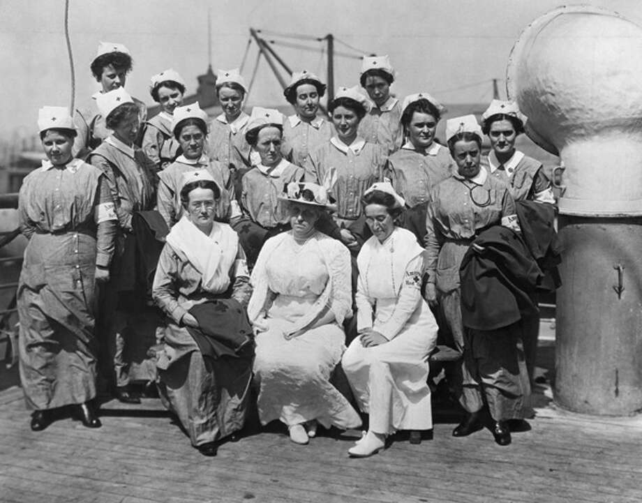 A group of nurses pictured in uniform on board the S.S. Red Cross, one of the first units of American Red Cross nurses to sail from New York for service in Europe during World War 1. The nurses shown are (top row, from left): Mary F. Bowman, Eva L. Doniat, Edwina Klee, Gertrude G. Hard and Charlotte Eaton; (middle row, from left) Alma E. Foerster, Lyda N. Anderson, Anne Hanson, Julia S. Schneider, Genevieve Dyer, Martha M. Moritz, Alica Giloborne and Mary E. Hill; (seated, from left) Charlotte Burgess, unit supervisor; Jane A. Delano (1862-1919), and Miss. H. Scott Hay, who was in charge of the 120 nurses aboard the ship. Photo: Kean Collection, Getty Images / 2010 Getty Images