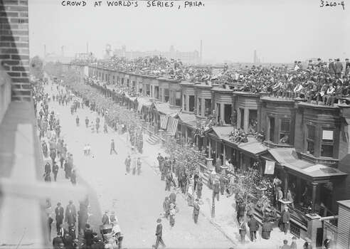 Crowds gather on rooftops across from Shibe Park to watch the Philadelphia Athletics play the Boston Braves during the 1914 World Series. Photo: Buyenlarge, Getty Images / Archive Photos