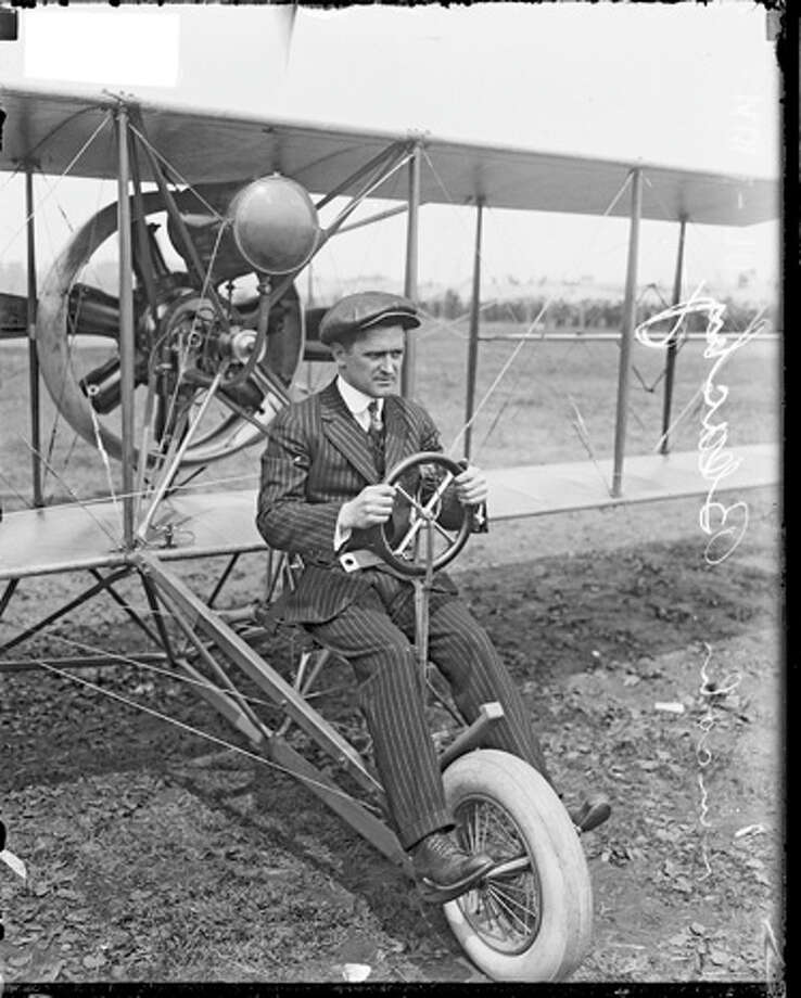 Lincoln Beachey sits in an airplane on a dirt field. Photo: Chicago History Museum, Getty Images / Property of Chicago Historical Society.  Not to be reproduced or used without written permission from CHS Rights & Reproductions Dept.