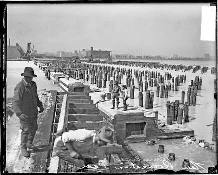 Construction on a new municipal pier in Chicago, Ill. is pictured Sept. 17, 1914. Photo: Chicago History Museum, Getty Images / Property of Chicago Historical Society.  Not to be reproduced or used without written permission from CHS Rights & Reproductions Dept.