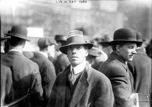 A man attends a rally of the Industrial Workers of the World (IWW) or the Wobblies, wearing a hat with a placard bearing the slogan 'Bread Or Revolution', in Union Square, New York, April 11, 1914. The crowds were estimated to be 3,000 strong. Photo: Interim Archives, Getty Images / Archive Photos