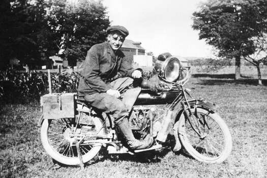 Walter Wright sits on a 2-speed Indian motorcycle.  Indian motorcycles were manufactured from 1901 to 1953 by a company in Springfield, Mass., initially known as the Hendee Manufacturing Company.  It was renamed the Indian Motorcycle Manufacturing Company in 1928. Photo: RacingOne, ISC Archives Via Getty Images / 2012 RacingOne