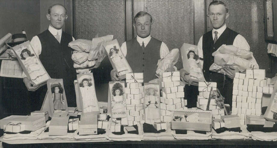 Members of the courtesy committee of the Colorado Electric club prepare celebration packages that will be given to Denver children at the big Denver Post-Colorado Electric club Christmas celebration. Left to right - W.A. Roper, C.F. Oehlmann and M.C. Gordon. Photo: The Denver Post, Denver Post Via Getty Images / (C) 2010 The Denver Post, MediaNews Group
