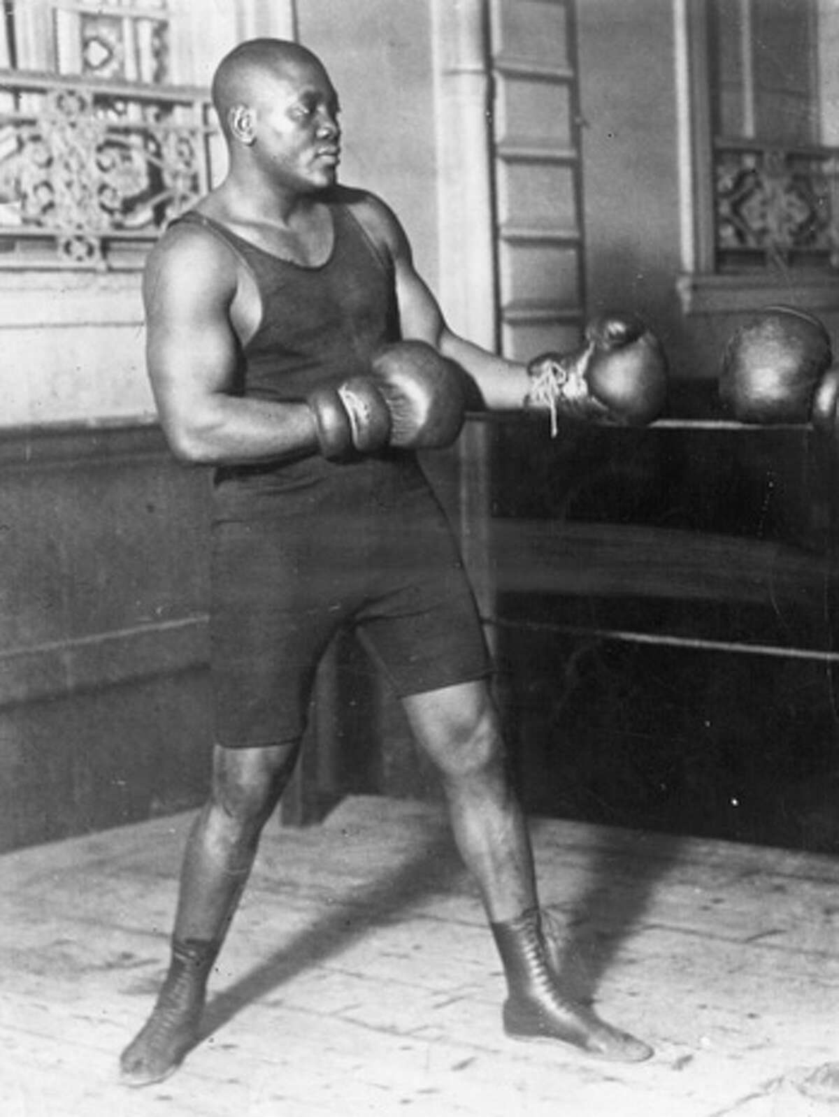 American heavyweight boxer Jack Johnson (and Galveston native) is shown sparring. Johnson's legacy was recently honored with a statue in his hometown.