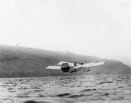 Aviation pioneer Glenn Curtiss flies a modified version of Samuel Langley's 'Aerodrome' over Kenka Lake, New York. Photo: Hulton Archive, Getty Images / Hulton Archive