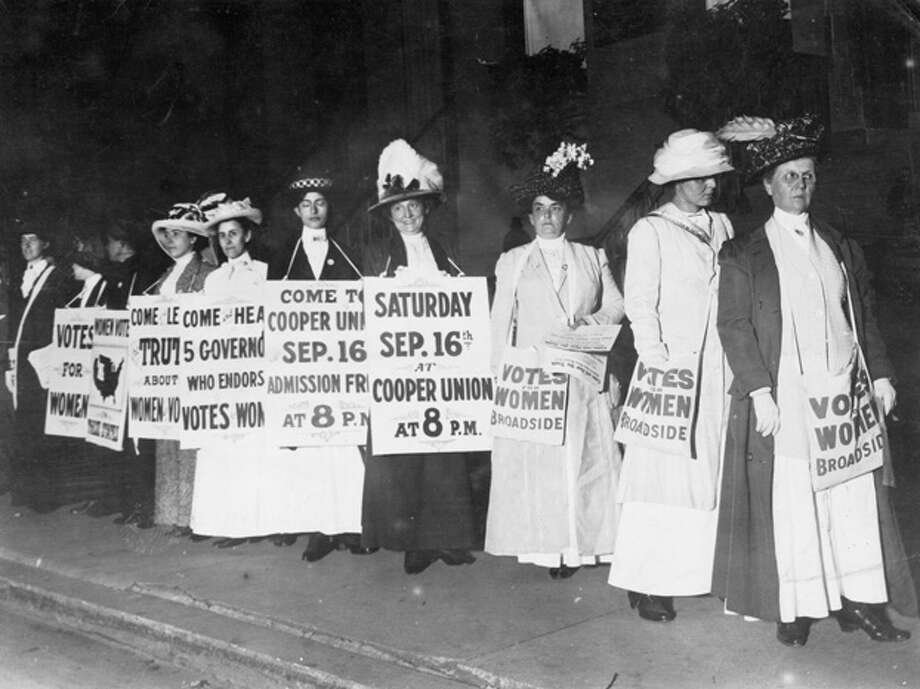 Society women wearing sandwich boards to publicize a talk at Cooper Union by the governors of the states that have granted the vote to women. Photo: Paul Thompson, Getty Images / Hulton Archive