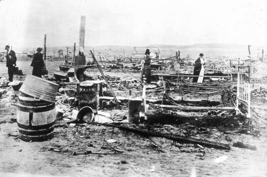 A group of people examine the ruins of the Ludlow colony in Colorado. Built as a temporary shelter for striking coal miners and their families, it was attacked by militiamen and company detectives who shot and burned to death eighteen people including eleven children, the youngest of whom was only three months old. Photo: MPI, Getty Images / Archive Photos