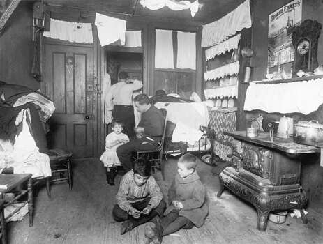 A family relaxes in their tenement home in New York City. Photo: Hulton Archive, Getty Images / Archive Photos