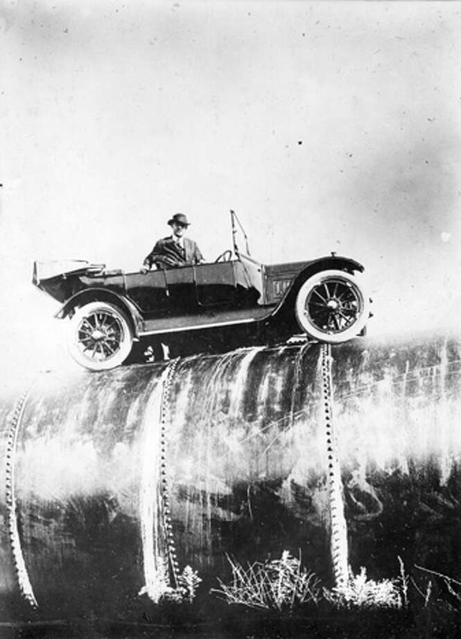 Bert Dingley drives a car along a section of the immense aqueduct at Los Angeles, Calif. Photo: Topical Press Agency, Getty Images / Hulton Archive