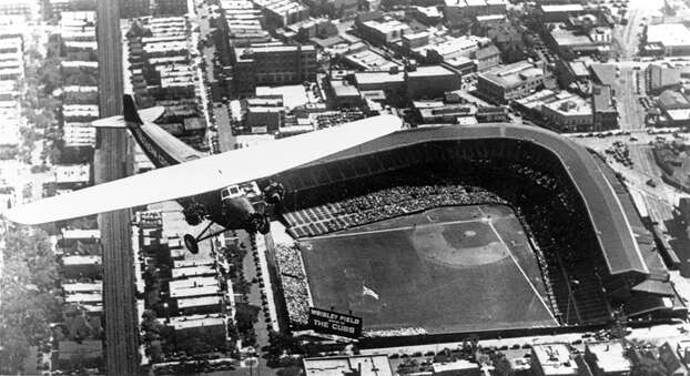 An aerial view shows Wrigley Field in Chicago.  Wrigley Field opened April 23, 1914 as the home of the Chicago Cubs. Photo: MLB Photos, MLB Photos Via Getty Images / 1914 MLB Photos