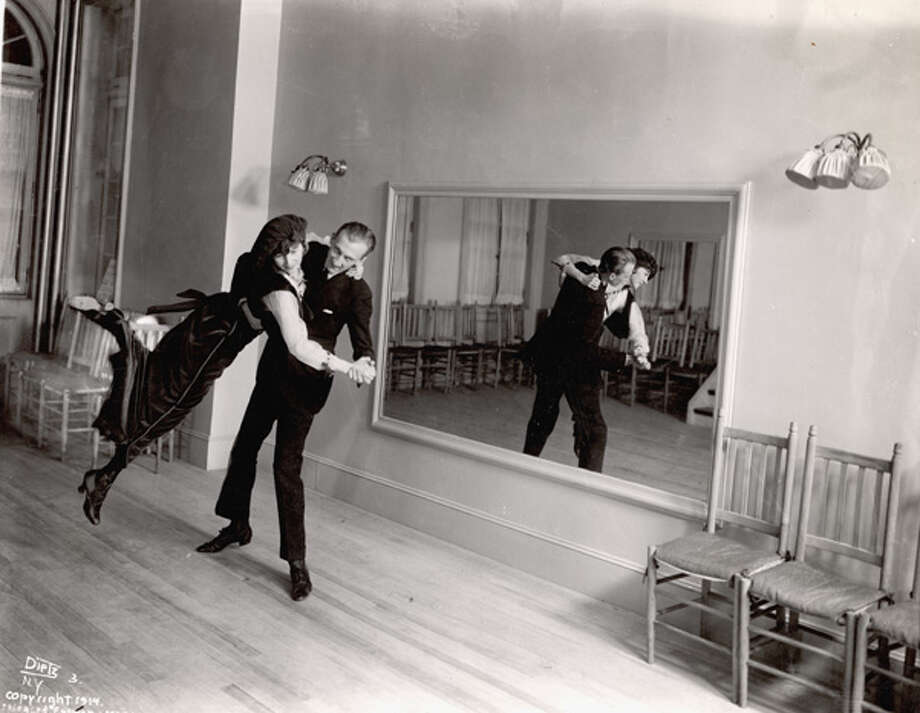 Legendary ballroom dancer Vernon Castle lifts his wife and partner Irene as they dance before a large mirror in a dance studio in New York in 1914. Photo: FPG, Getty Images / 2004 Getty Images