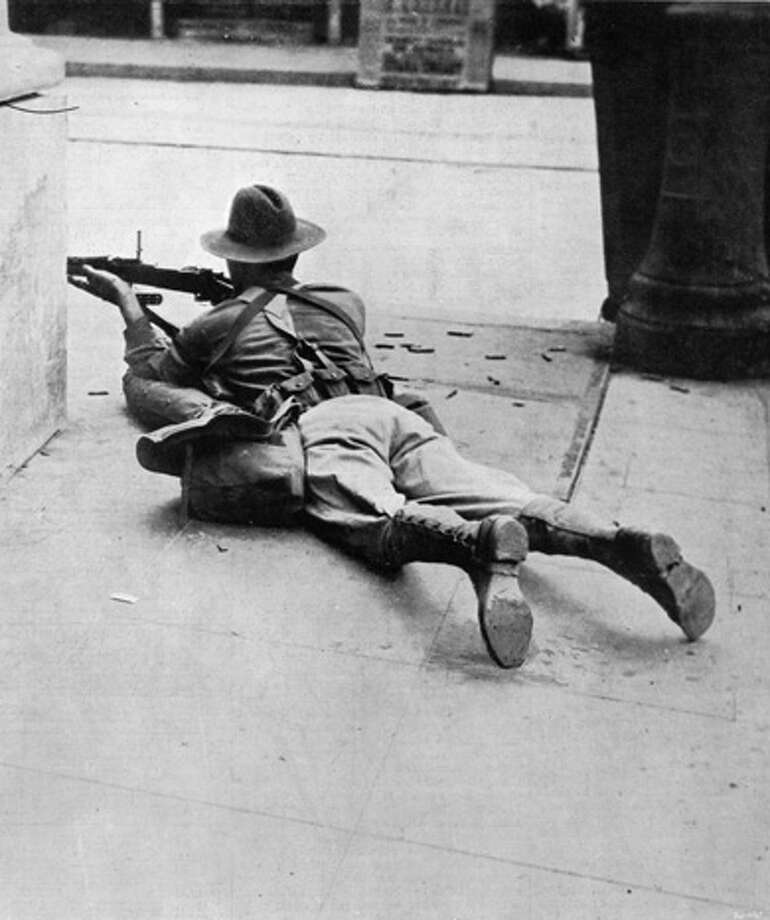 An American Marine sharpshooter aims a 1903 Springfield rifle at opponents during the American intervention in the Mexican Revolution in Vera Cruz, Mexico in 1914.  Photo: Time Life Pictures, Time & Life Pictures/Getty Image / Time Life Pictures