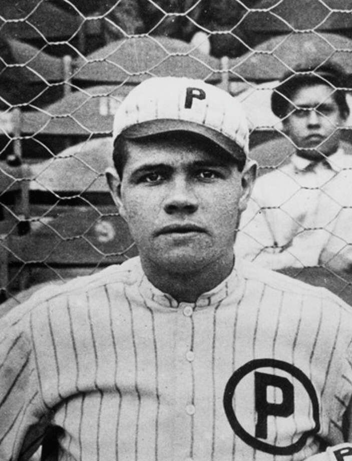 Babe Ruth, pitcher for the Providence Grays minor league team, poses for a team photograph in 1914. Photo: Transcendental Graphics, Getty Images / 2006 Mark Rucker/Transcendental Graphics