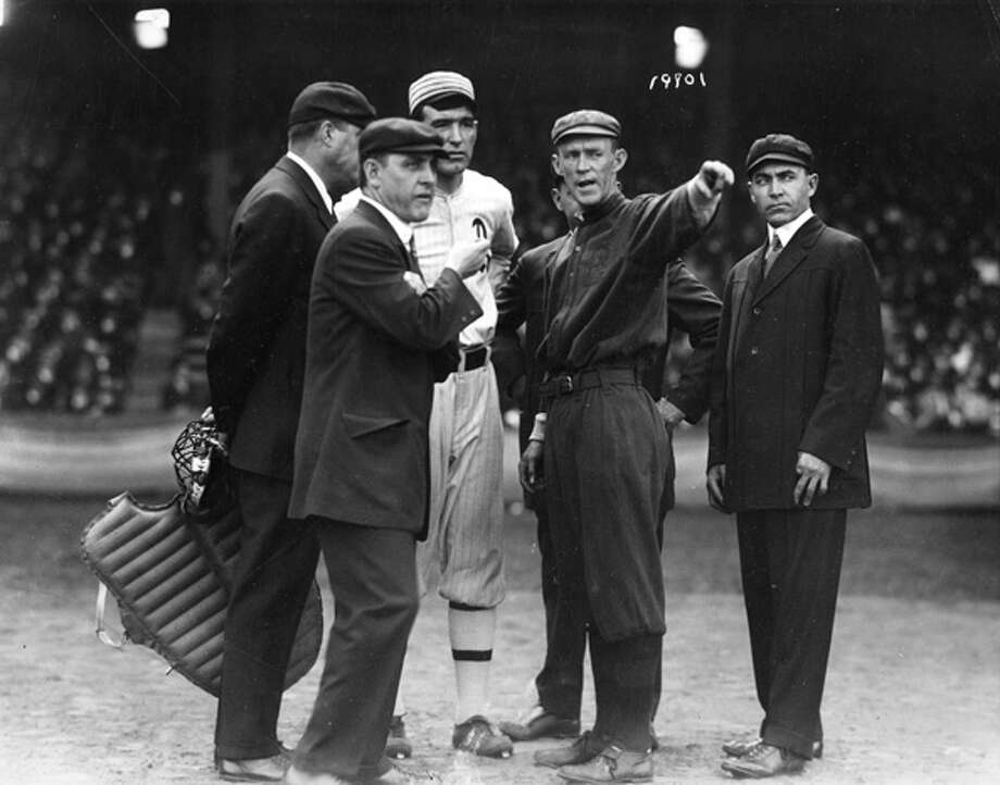 Johnny Evers, captain and second baseman for the Boston Braves, goes over the ground rules at Fenway Park with Ira Thomas, Athletics captain and the umpiring crew before the start of game three of the 1914 World Series on October 12th. Photo: Transcendental Graphics, Getty Images / 2006 Mark Rucker/Transcendental Graphics
