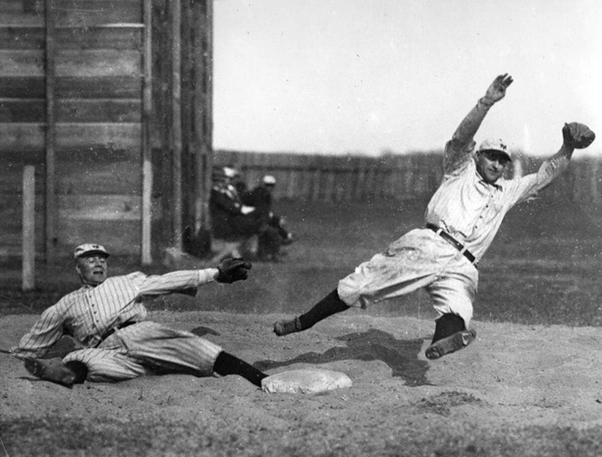George Burns, left, and Art Fletcher leap and stretch during spring training drills for the New York Giants in Marlin, Texas on March 14, 1914.