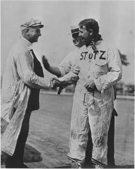 Race car driver Barney Oldfield shakes hands with photographer Louis Van Oeyen in April 1914 in Cleveland, Ohio. Photo: Louis Van Oeyen/ WRHS, Getty Images / 1914 Western Reserve Historical Society