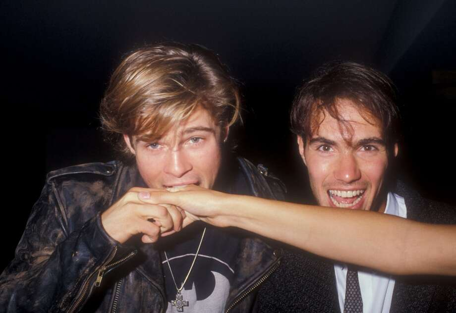 Here are Brad Pitt and Neal Barry, getting ready to snack on a disembodied female arm. But whose arm is it? The world will never know. Photo: Barry King, WireImage