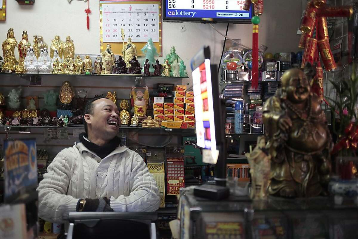 Thuy Nguyen, owner of Jenny's Gift and Kids Wear laughs as he sells another lottery ticket in San Jose, Calif. on Wednesday, Dec. 18, 2013. A patron of Jenny's Gift & Kids Wear in San Jose, Calif. won a lottery of $324 million and Thuy Nguyen of the store was also awarded one million.