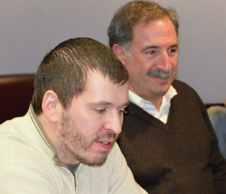 Westporter Michael Ray, left, came to the Green Task Force meeting Tuesday to advocate ways to limit the noise and pollution generated by leaf blowers in town. State Rep. Jonathan Steinberg, right, was among those listening to his ideas at the Town Hall meeting. Photo: Jarret Liotta / Westport News contributed
