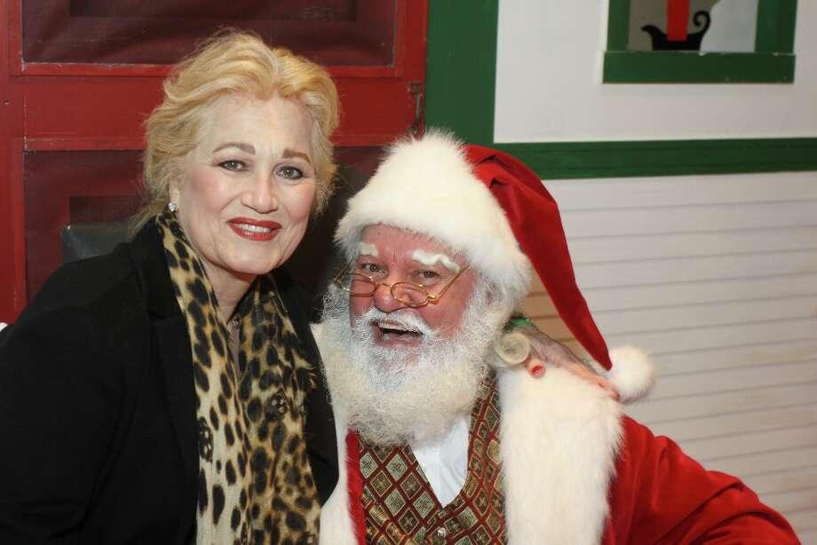 Mary Kickerillo with Santa at the MD Anderson Santa Breakfast Photo: Gary Fountain, Copyright 2013 Gary Fountain. / Copyright 2013 Gary Fountain.