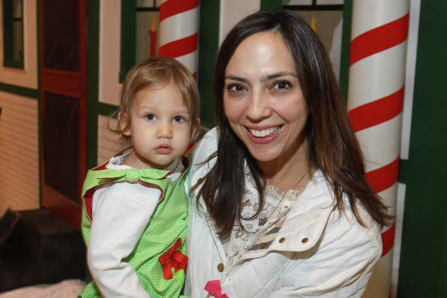 Veronica Pullicino with Emma at the  MD Anderson Santa Breakfast Photo: Gary Fountain, Copyright 2013 Gary Fountain. / Copyright 2013 Gary Fountain.