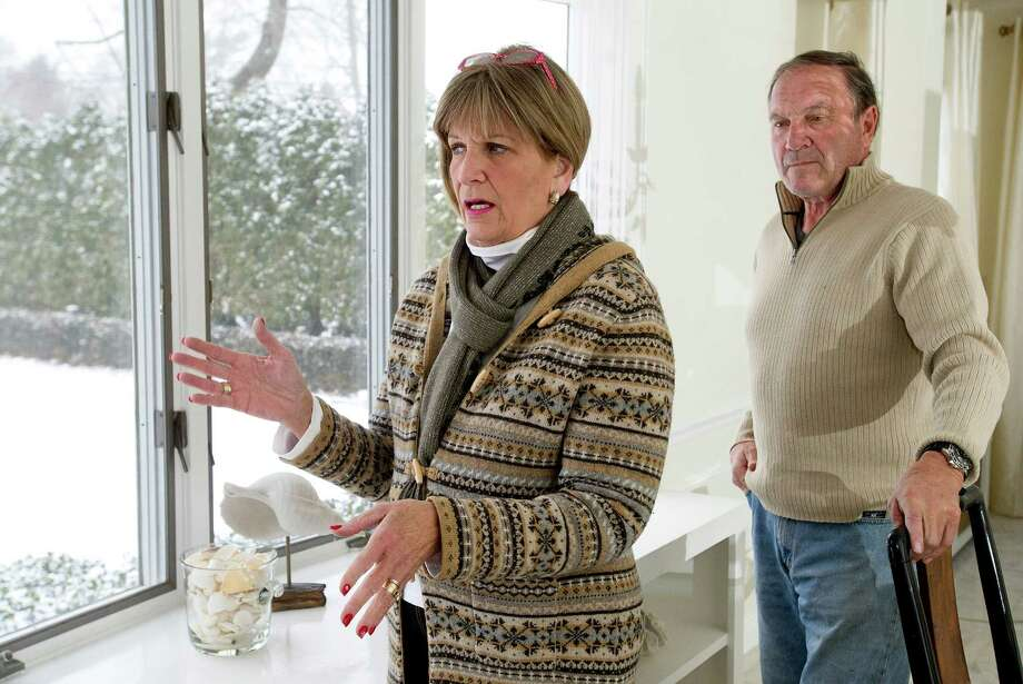 Jane and John Aikler discuss the history of their home on Shippan Ave. on Tuesday, December 18, 2013. Photo: Lindsay Perry / Stamford Advocate