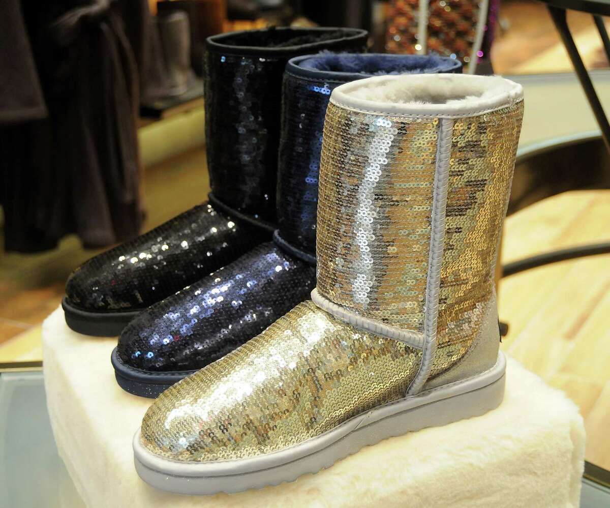 Some flashy examples of the original style boots at the UGG store at the Galleria Friday Nov.22, 2013. (Dave Rossman photo)