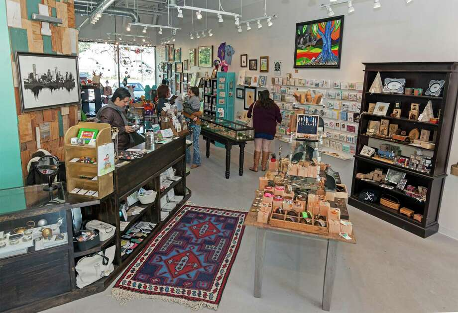 From the left: The new 1,200 square-foot Space Montrose touts artisan wares. Fuzzy dolls and Monster Hoodies by Diane Koss for sale. Photo: Craig Hartley, Freelance / Copyright: Craig H. Hartley