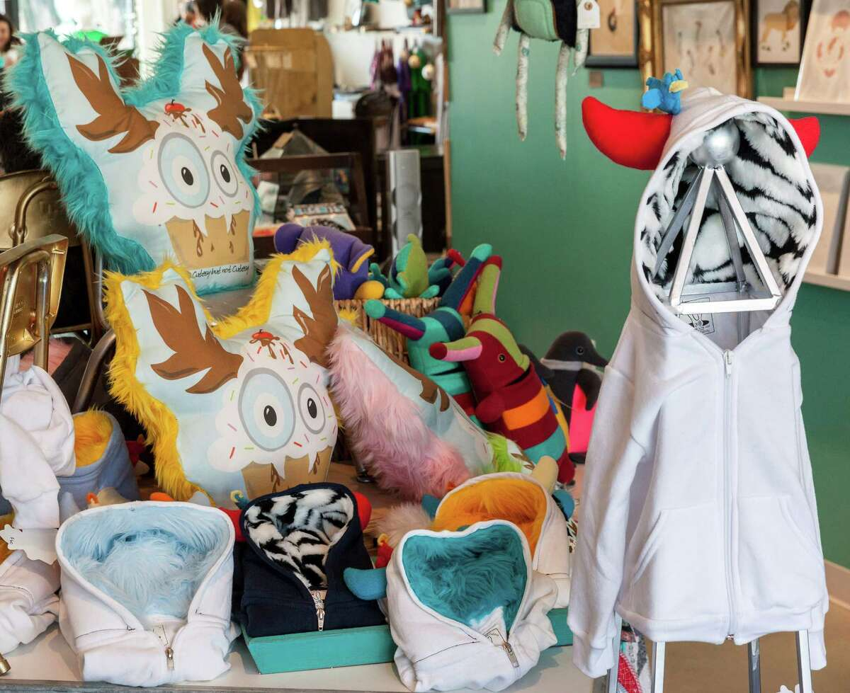 From the left: The new 1,200 square-foot Space Montrose touts artisan wares. Fuzzy dolls and Monster Hoodies by Diane Koss for sale.