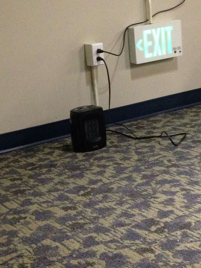 Space heaters were being used during the Dec. 10 Board of Education meeting in an attempt to warm the meeting room. Photo: Megan Spicer / Darien News