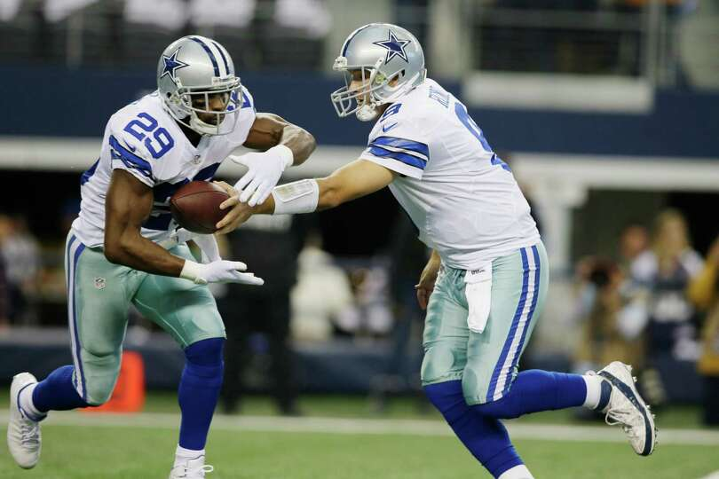 Dallas Cowboys quarterback Tony Romo (9) hands the ball to running back DeMarco Murray (29) during t