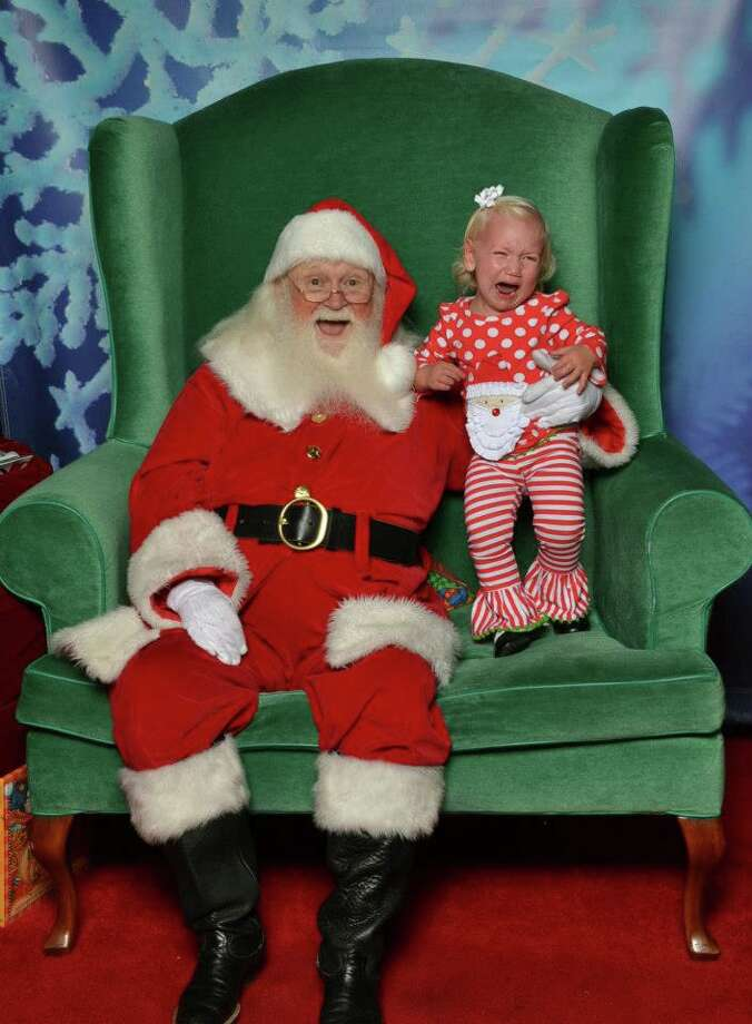This is our daughter Grace. She was so excited to see Santa, even trying to skip people in line. She was doing great from afar, the second we went up to him she started crying. I tried sitting with her, but that did not work so I quickly hopped out and this is what we got!!! It is by far our favorite one yet!