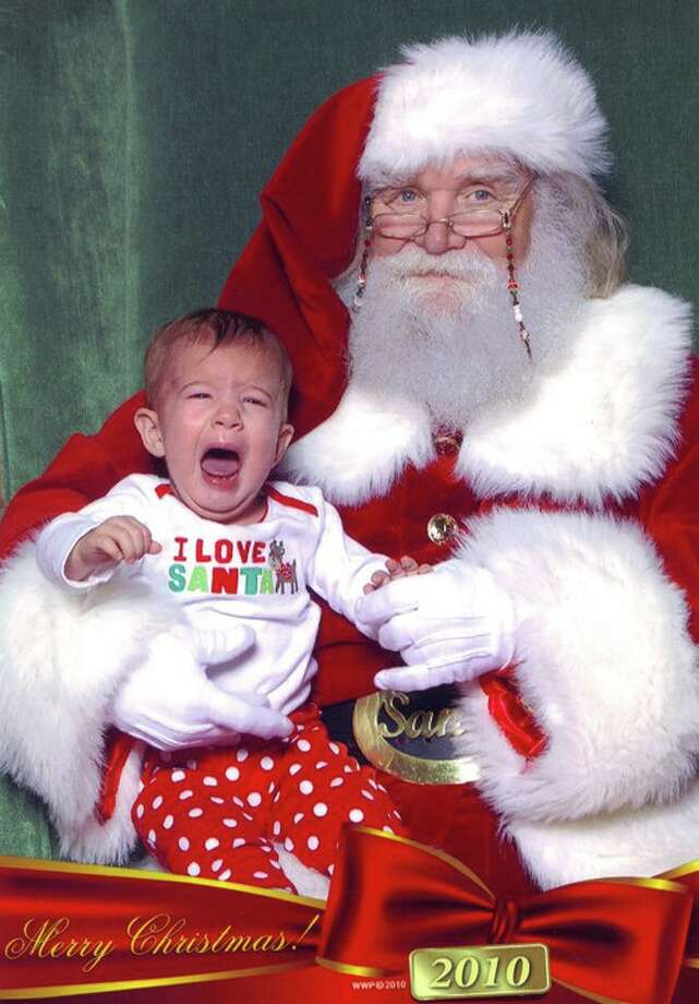 Our one year old granddaughter, Callan, may have the shirt professing love for Santa but she's not showing it in this picture! And Santa doesn't look too happy about it either. You can only imagine what he's thinking. Now that she's four she likes the big guy a lot more.