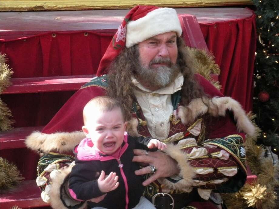 This picture was taken at the Renaissance Festival during the Christmas weekend of 2013. I think Zoe hurt Santa's feelings. He started to cry when she did! :)