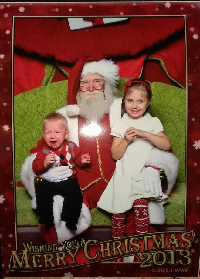 This was my sons first time meeting Santa. He was terrified. My daughters forth time with Santa and first time she was not terrified. Classic photo we will love forever. Merry Christmas!!!  Jason Sprinkle
