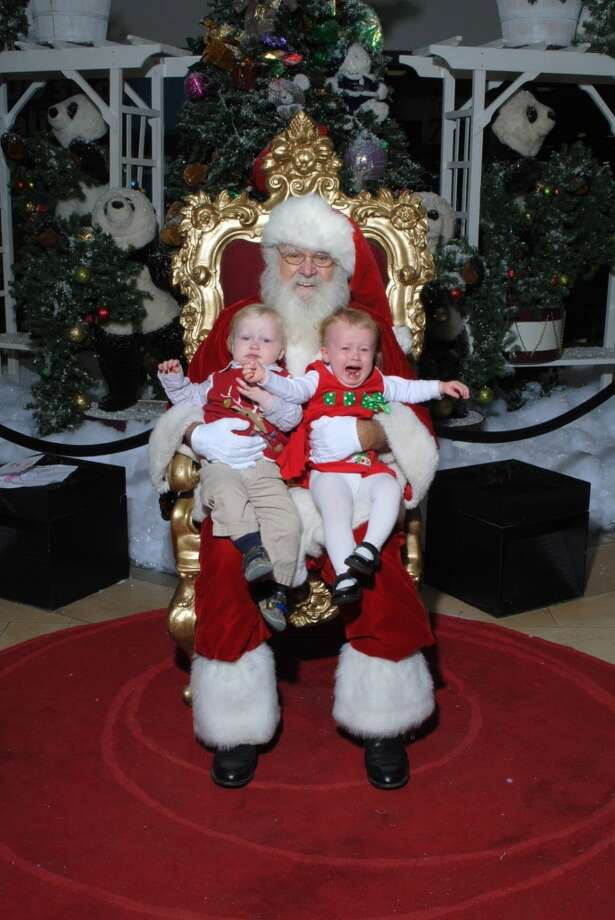 My boy/girl twins are 20 months old. I took them to Northwest Mall this past weekend and my daughter did not like Santa! My son didn't really mind him, I think he was more scared of his sister screaming. It made for a funny picture.  Jessica Nute