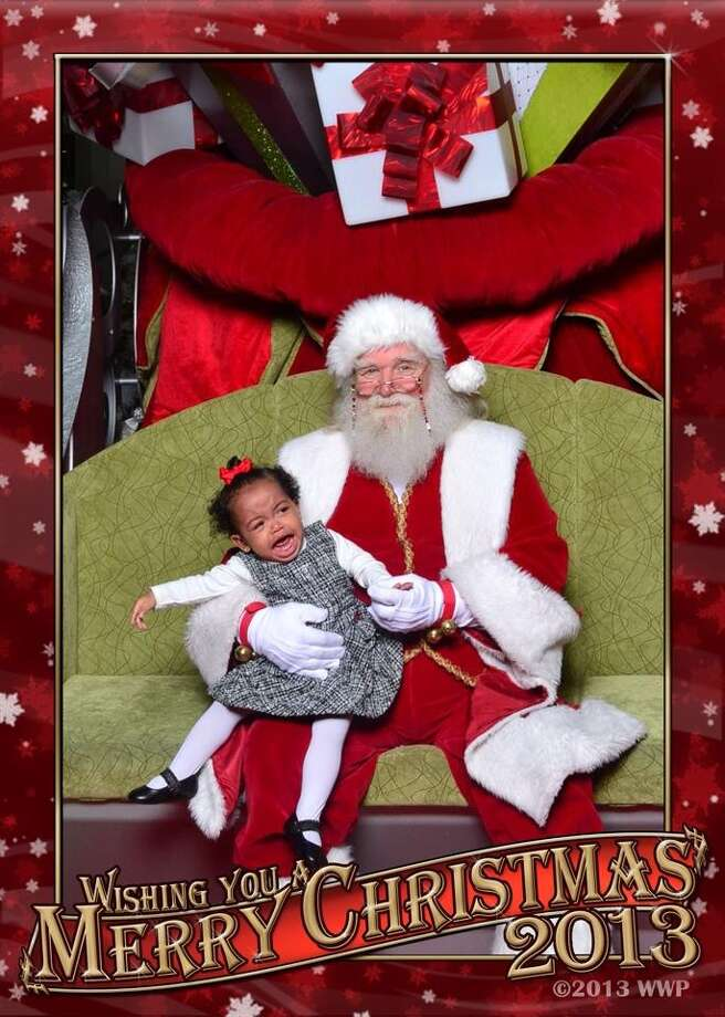 This is my granddaughter Nova Rose and her first picture with Santa. My daughter tried to calm her with candy, but nothing worked. This is the best of many pictures taken. In my eyes it's priceless.
